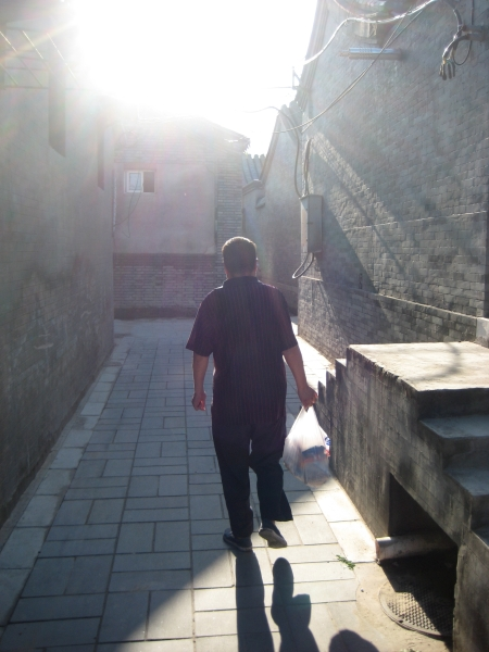 Walking the streets of Beijing, China.  Photo: Bobak Tavangar