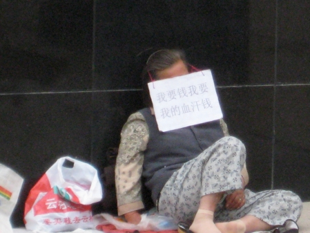 Stuck in poverty in Beijing.  Photo: Bobak Tavangar